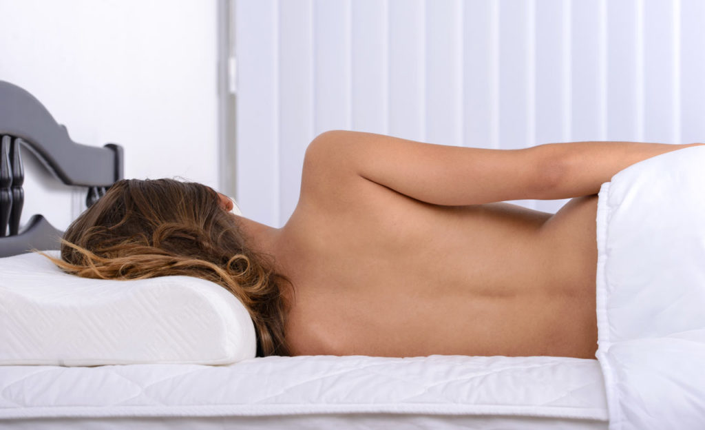 Pros and Cons of Sleeping in Pajamas vs. Naked